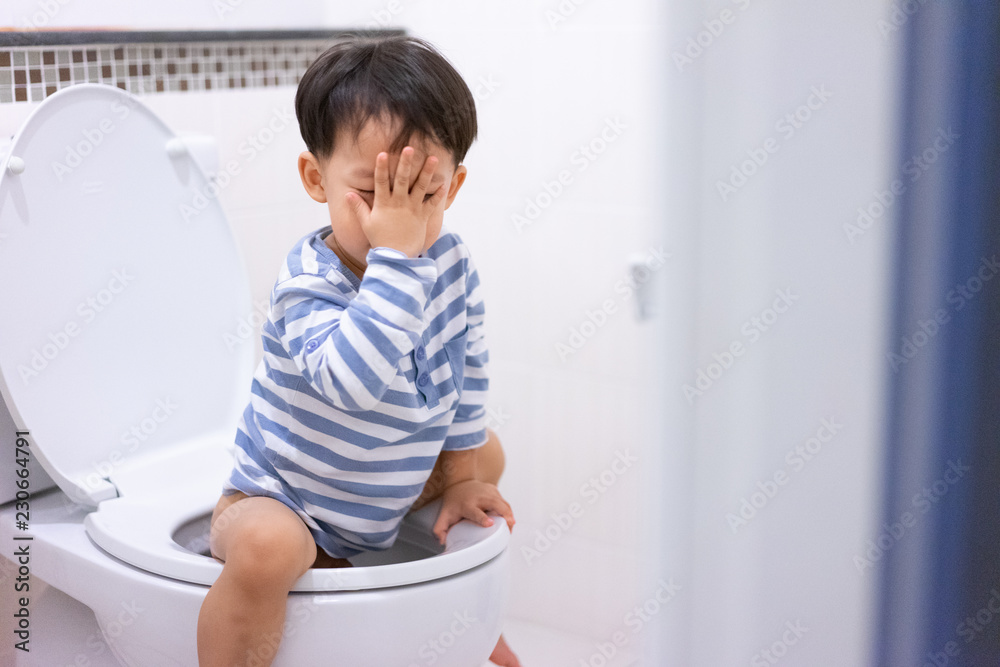 Fototapety, obrazy: Little boy poo and pee in white toilet.