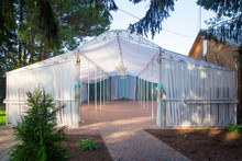 Photo Of White Wedding Canopy In Summer