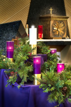 This Large Christmas Advent Wreath Is On Display To Celebrate The Catholic Christmas Holiday.