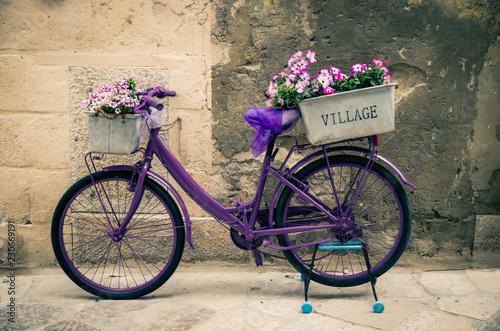 Foto op Plexiglas Fiets Vintage violet bike bicycle with box of flowers, Italy