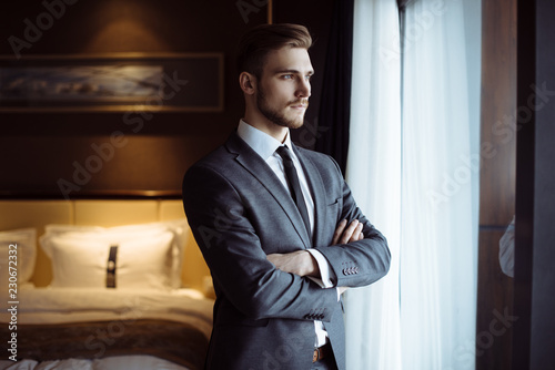 Young handsome man relaxing at his apartment in a hotel after business meeting Fototapete