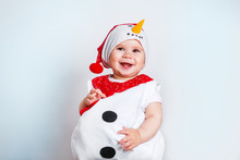 Merry Christmas And Happy New Year. Happy Baby Girl In Snowman Costume On White Background
