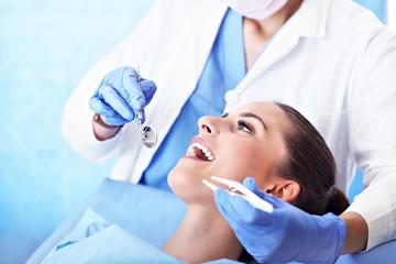 Fototapeta Adult woman having a visit at the dentist's