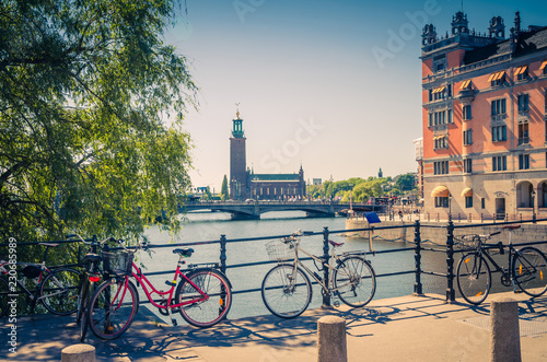 Photo  Bike near bridge railing and Stockholm City Hall (Stadshuset), Sweden