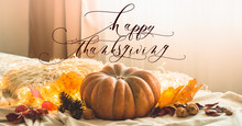 Happy Thanksgiving Text. In Home Decorated Pumpkin, Cones, Walnuts And Autumn Leaves Garland. Autumn Fall Holidays. Cozy Mood