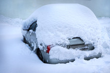 A Car Under A Pile Of Snow.