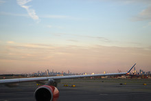 Airplane Wing Over New York City Skyline.