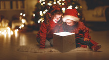 Merry Christmas! Happy Children With Magic  Gift  At Home