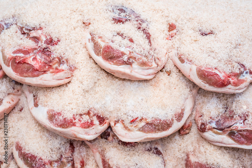 Salting process of iberian ham. Meat industry concept.