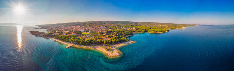 Aerial view of seaside promenade in Supetar town on Brac island with palm trees and turquoise clear ocean water, Supetar, Brac, Croatia, Europe