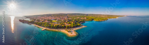 Ingelijste posters Kust Aerial view of seaside promenade in Supetar town on Brac island with palm trees and turquoise clear ocean water, Supetar, Brac, Croatia, Europe
