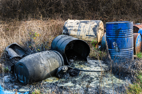 Barrels of toxic waste in nature Fotobehang