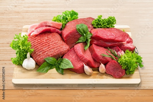 Heap of raw meat with garlic and
