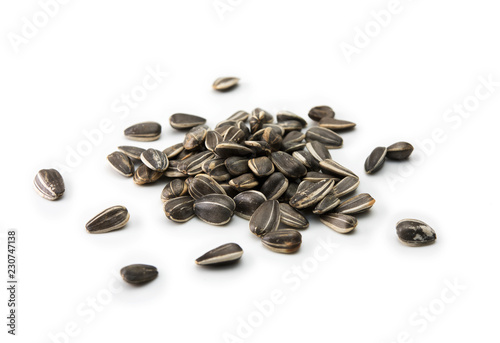 Fotomural Sunflower (Helianthus annuus) seeds, isolated on white.