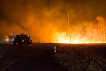 Firefighters Extinguish A Forest Fire. Forest Fire At Night.
