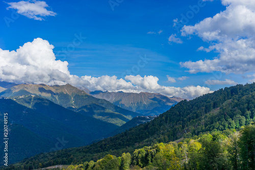 Mountain landscape against cloudy blue sky in Krasnaya Polyana Sochi