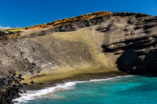 Green Sand Beach (papakolea) Near South Point On Hawaii's Big Island. Steep Slope Of Old Volcano Cone Is Behind The Beach; Blue-green Ocean & Deep Blue Sky.