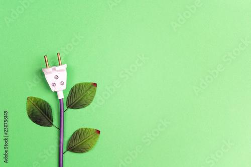 Electrical plug with leaves like a plant. Eco, bio, energy saving concep.