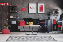 Raspberry Red Accents In Stylish Living Room Interior With Grey Industrial Furniture, Modern Coffee Table And Patterned Carpet