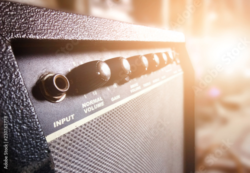 Guitar amplifier in recording studio background with