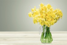 Narcissus Flowers In Vase On W...