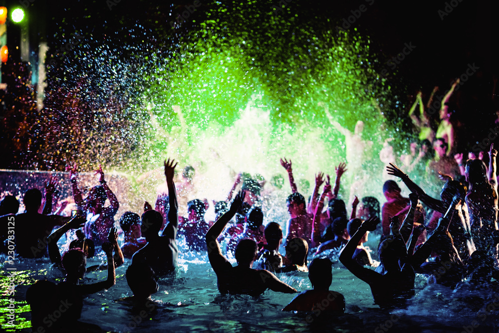 Fototapeta Night party of people in the pool.