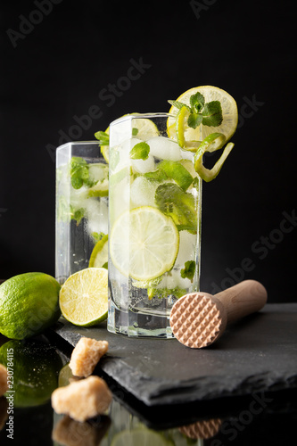 Two mojito cocktails in highball glasses