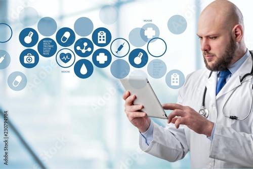 Spoed Foto op Canvas Wanddecoratie met eigen foto Doctor with digital tablet and variety medical