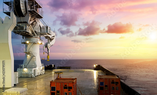 Fotografie, Obraz  Amazing Sunset view from a modern offshore ship with a large crane on deck