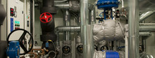 Equipment, Cables, Pipes And Valves In Engine Room Of A Ship Power Plant