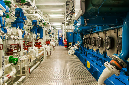 Fotografie, Obraz Equipment, cables, pipes and valves in engine room of a ship power plant