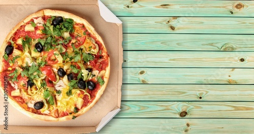Pizza delivery black box packaging background baked
