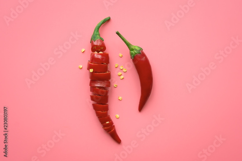Photo  Sliced Red Chili Pepper on pink background