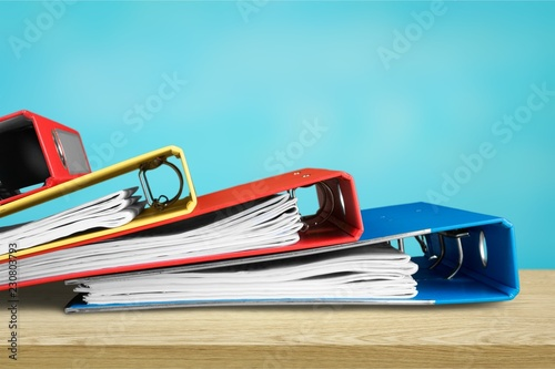Pile of files in folders and notebook