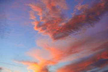 Sunset sky with orange clouds over blue