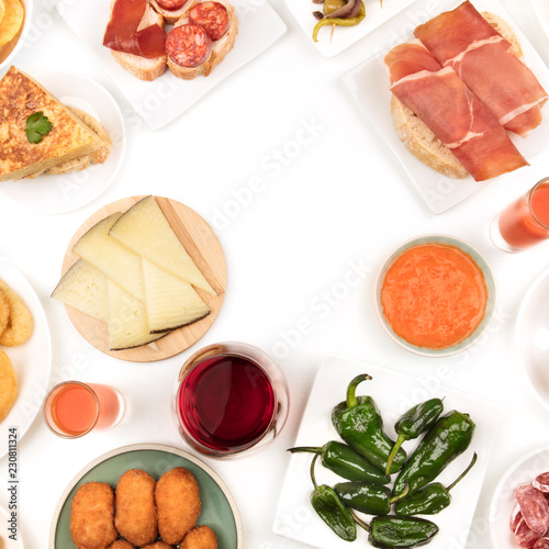 A photo of Spanish food, shot from the top. forming a frame on a white background with a place for text