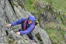 UK, Lake District, Longsleddale Valley, Buckbarrow Crag, Man Climbing In Rock Wall