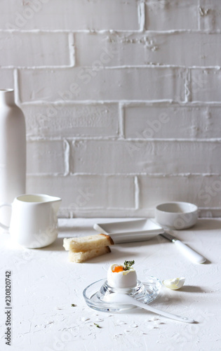 Traditional morning breakfast, boiled eggs, butter, bread, milk, on a white background, modern style