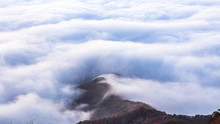 Beautiful View Above The Clouds On The Mountains From The Aerial View