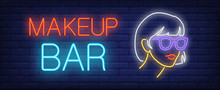 Makeup Bar Neon Sign. Glowing Neon Inscription With Girl In Glasses On Dark Blue Brick Background. Can Be Used For Beauty Salons, Advertisement, Outdoor Signs