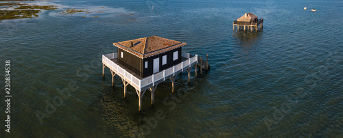 Photo Fishermen houses in Bassin Arcachon, Cabanes Tchanquees, Aerial view, France