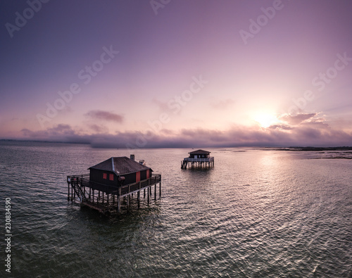 Fishermen houses in Bassin Arcachon, Cabanes Tchanquees, Aerial view, France Wallpaper Mural