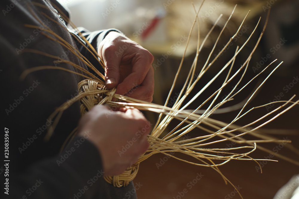 Fototapety, obrazy: Basketwork from willow twigs in the workshop.