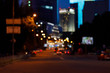 A far view blurred background of night busy city .