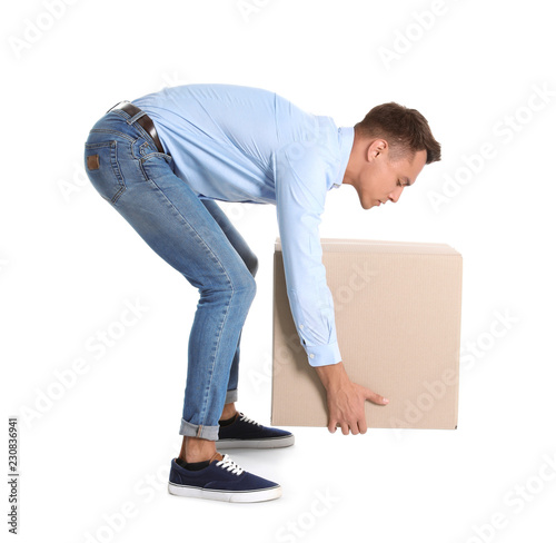 Fotografía Full length portrait of young man lifting heavy cardboard box on white background