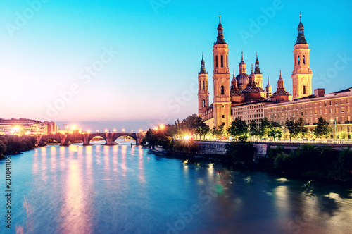 Beautiful sunrise landscape in Zaragoza. Spain. Aragon. Basilica of Our Lady of the Pillar in Zaragoza and Ebro River.