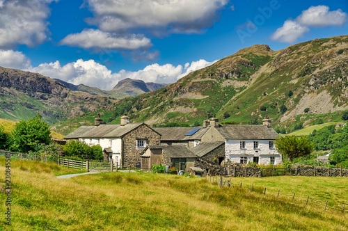 Obraz na plátne A group of traditional whitwashed cottages in the English Lake District