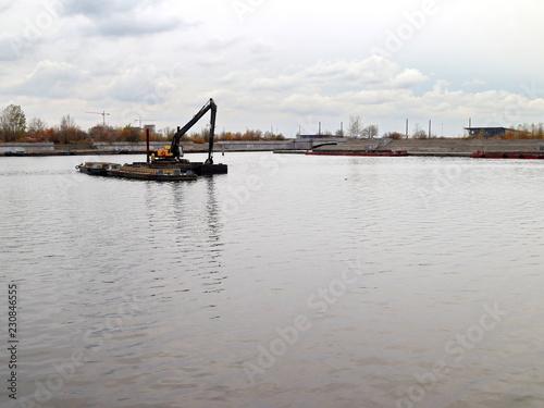 Valokuvatapetti dredging in the city reservoir