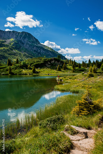 Foto op Aluminium Meer / Vijver Colbricon Lake and mountainscape in Trentino Alto Adige, Italy