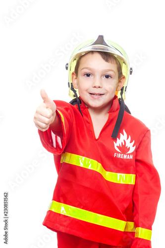 Fotografie, Obraz  Junge als Feuerwehrmann mit Daumen hoch